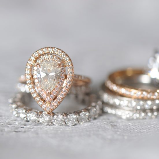 Pear double halo diamond ring and Wedding bands