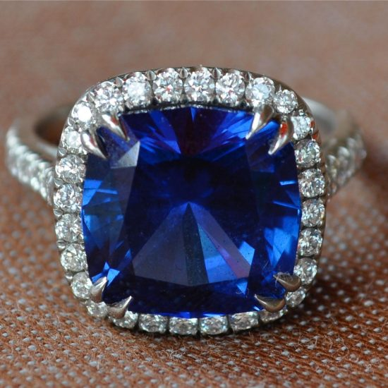 Sapphire and diamond halo engagement