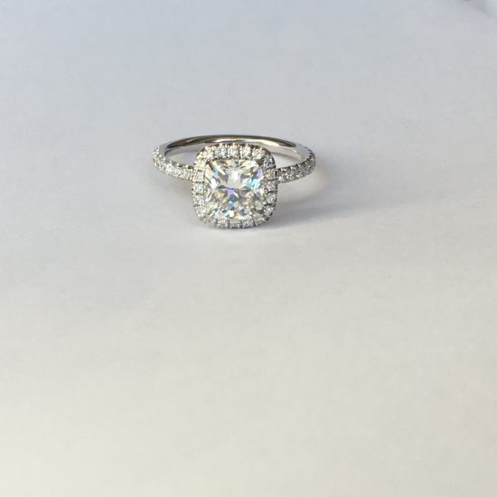 Cushion diamond engagement ring with halo