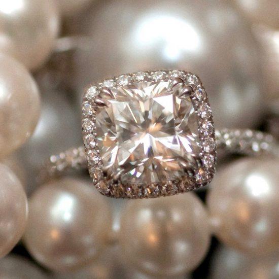Cushion diamond engagement ring with diamond halo