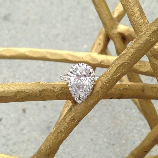 Pear diamond engagement ring with diamond halo