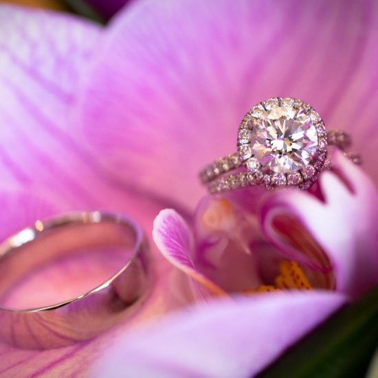 Round halo engagement ring and wedding bands
